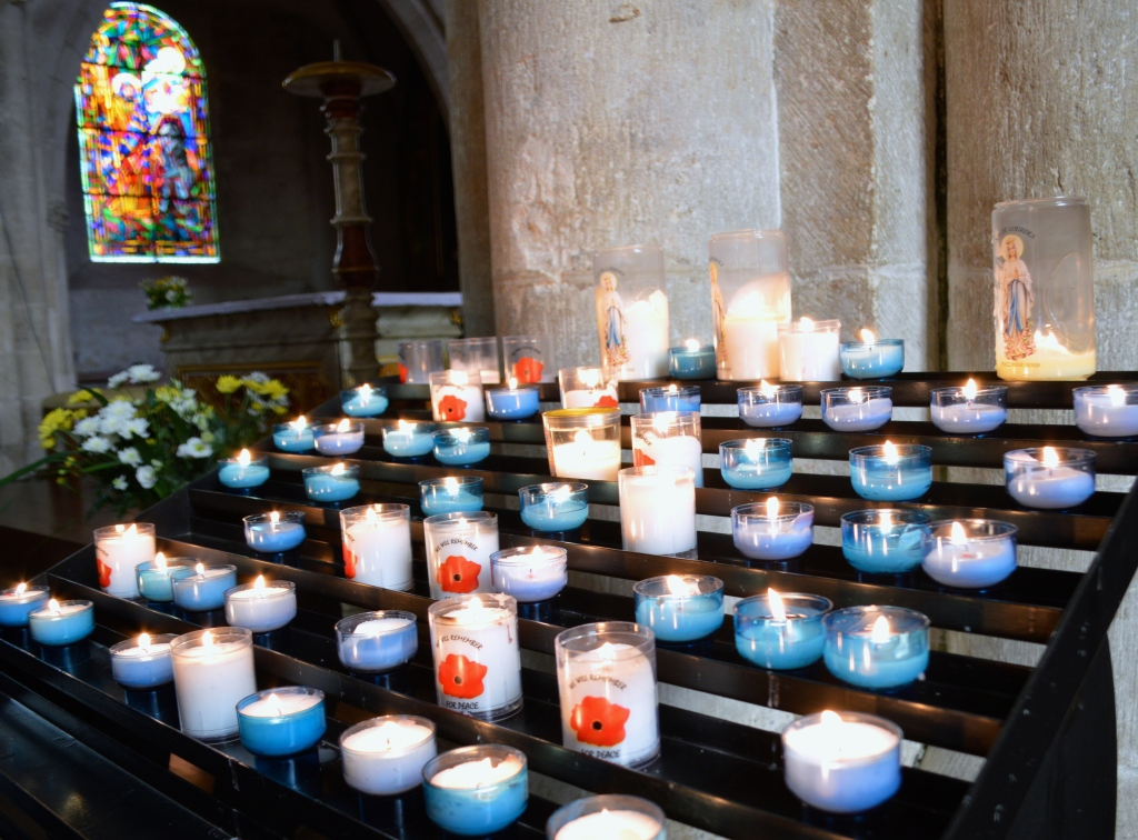 Saint Mere Eglise.  Candles for peace.